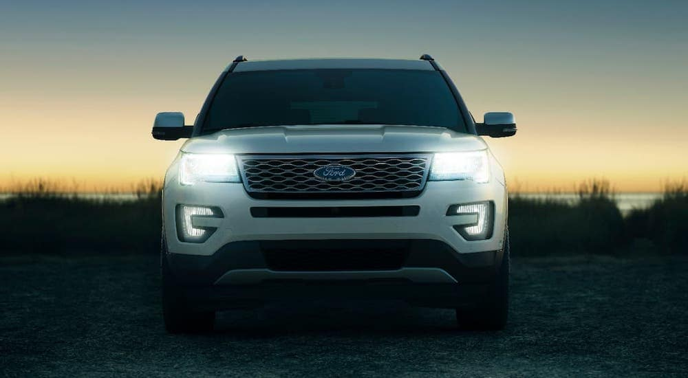 A white 2017 used Ford Explorer is shown from the front at dusk.