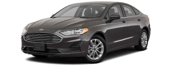 A black 2020 Ford Fusion is angled left.