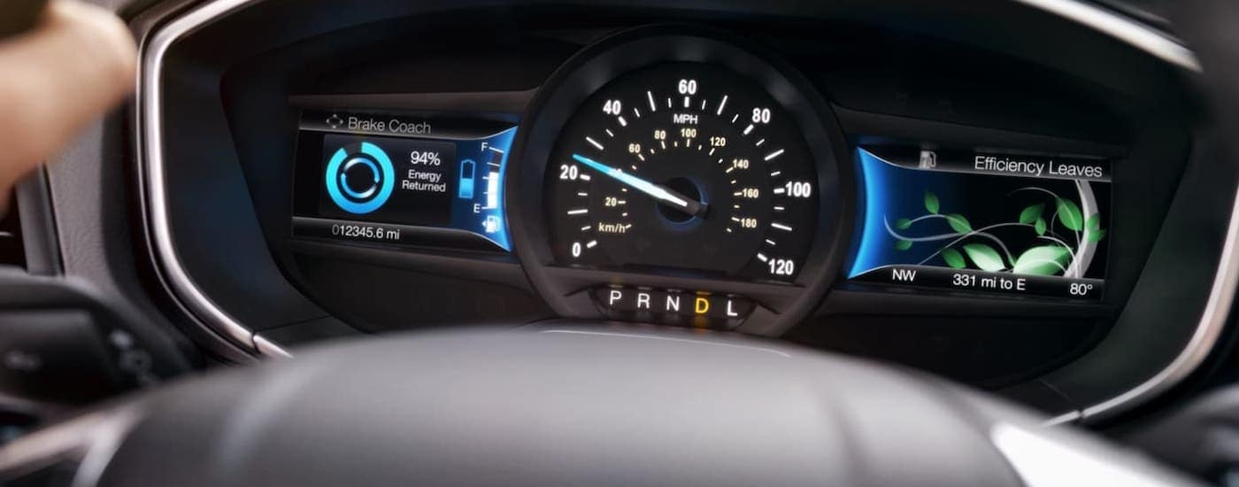 A closeup shows the information cluster on a 2020 Ford Fusion Hybrid.