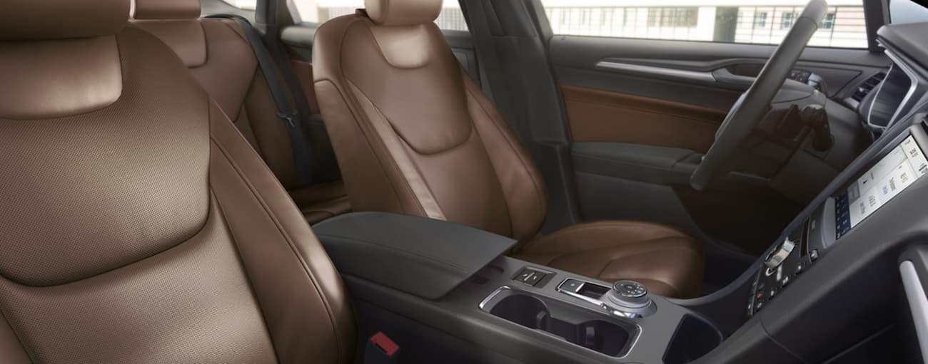The brown and dark grey interior of a 2020 Ford Fusion is shown.