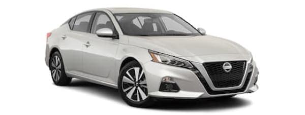 A white 2020 Nissan Altima is angled right.