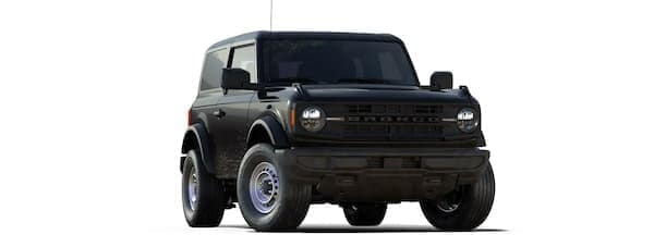 A black 2021 Ford Bronco two-door is angled right.
