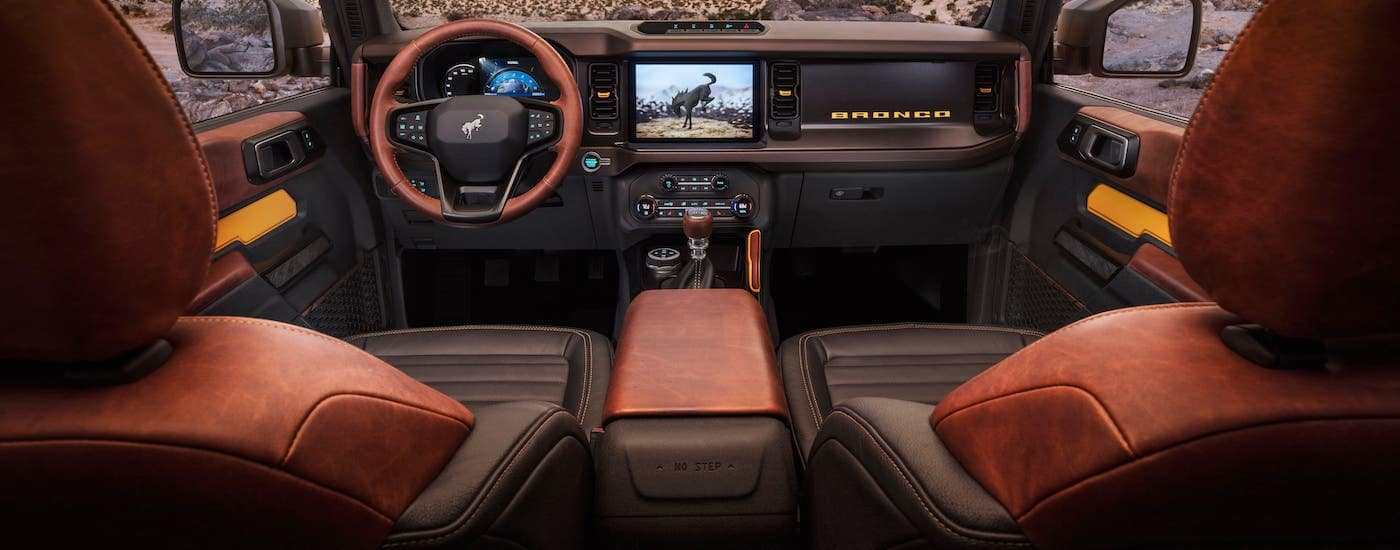 The available leather seats in a 2021 Ford Bronco are shown from between the front seats.