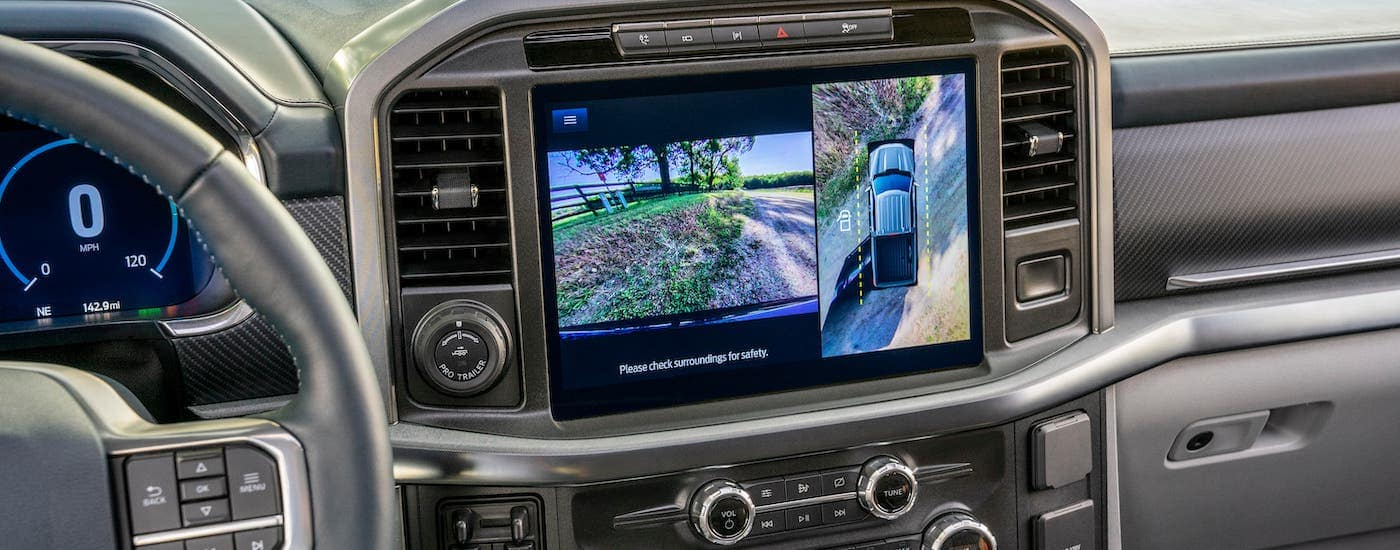 A closeup shows the infotainment screen and backup camera on a 2021 Ford F-150.