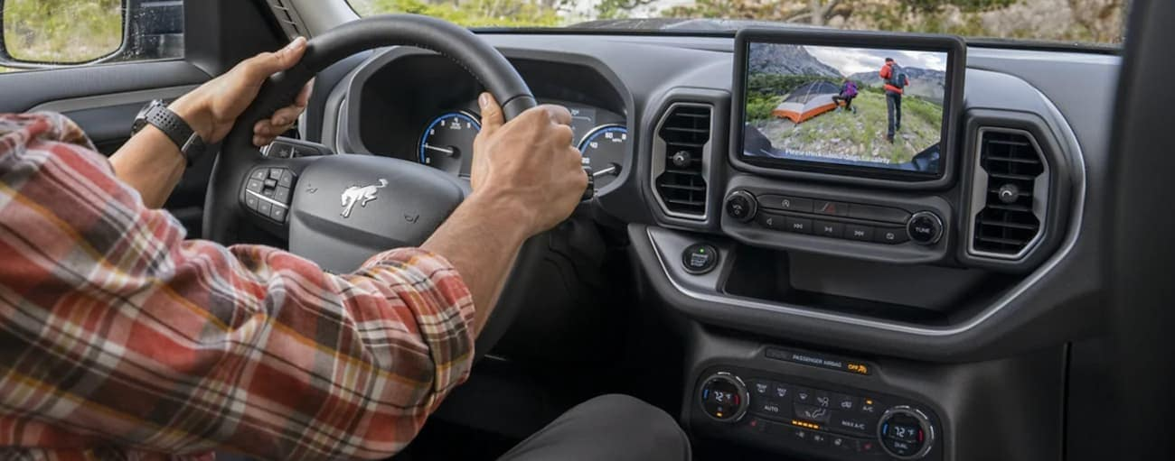 A driver is using the backup camera in a 2021 Ford Bronco Sport.