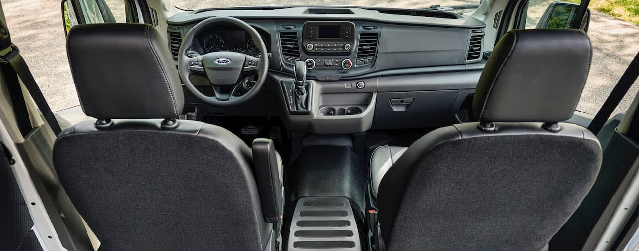 The black interior of a 2021 Ford Transit is shown.