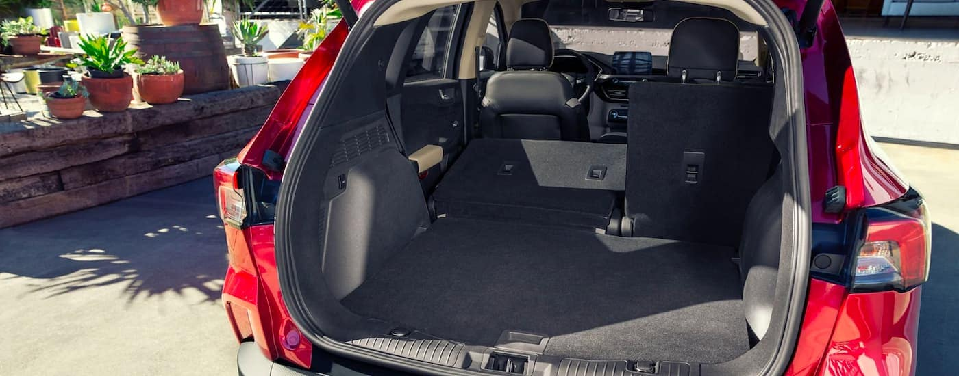 A close up is shown of the open trunk on a red 2021 Ford Escape.