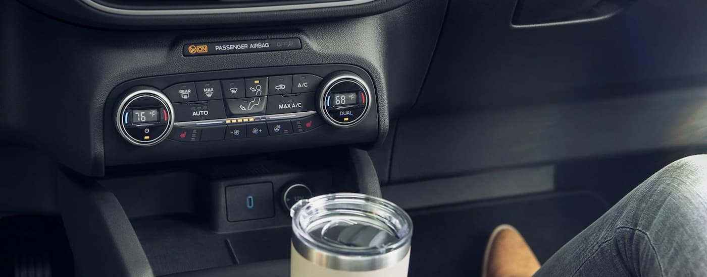 A close up is shown of the climate controls on a 2021 Ford Escape.