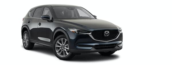 A black 2021 Mazda CX-5 is angled right.