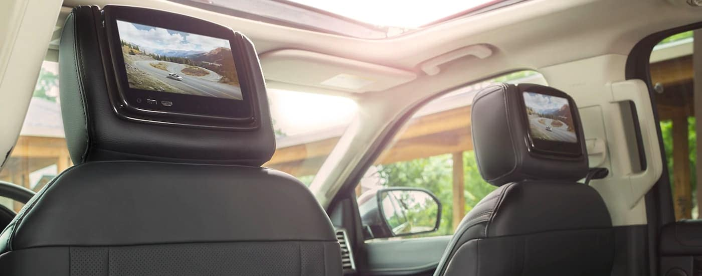 The black interior and head rest screens are shown in a 2021 Ford Expedition.