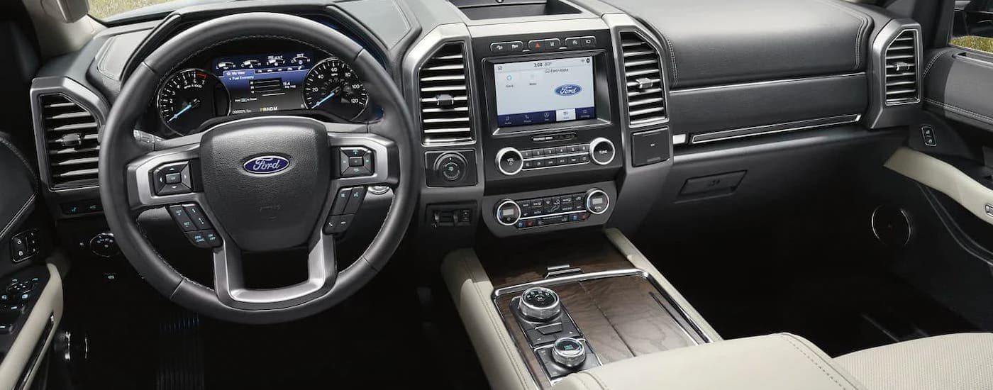 The gray front seats and interior of a 2021 Ford Expedition is shown.