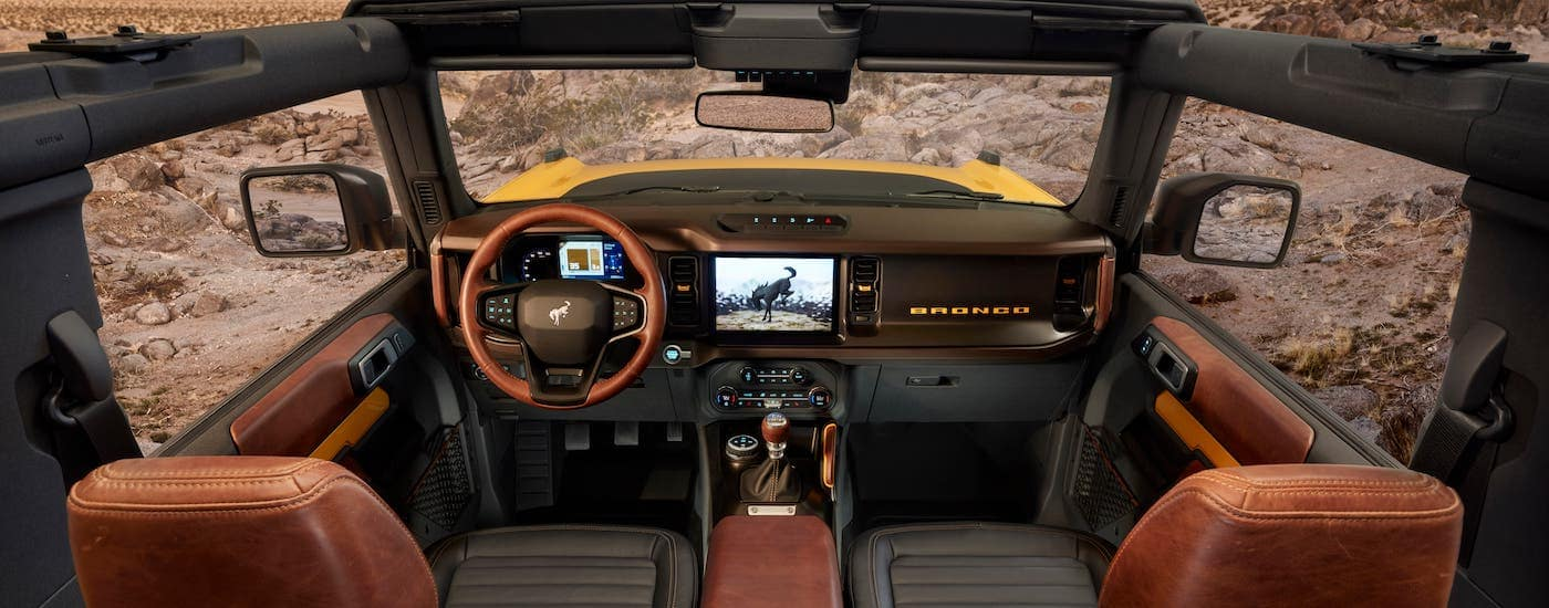 The interior and dashboard is shown in a 2021 Ford Bronco.