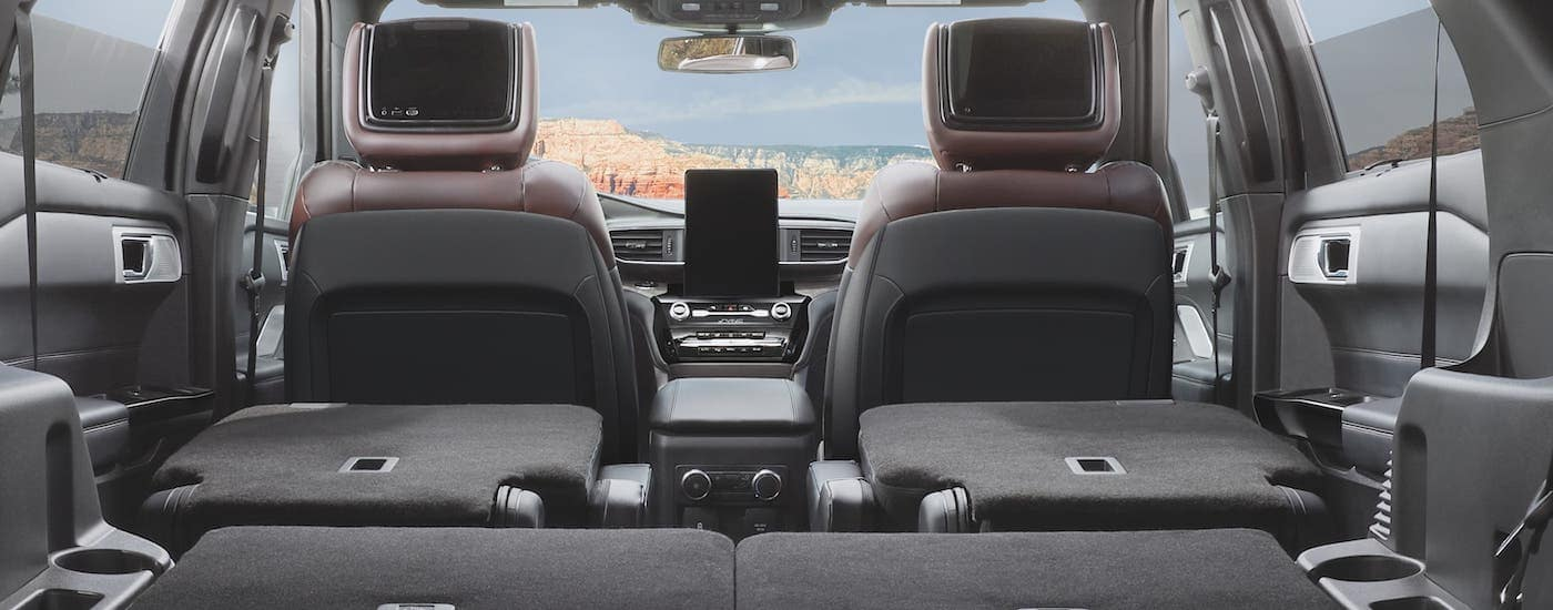 The rear seats are down and shown from the cargo area facing forward of a 2021 Ford Explorer.