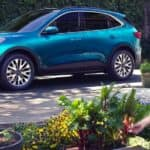 A blue 2021 Ford Escape is shown from the side parked in a garden after leaving an Albany Ford Escape dealership.
