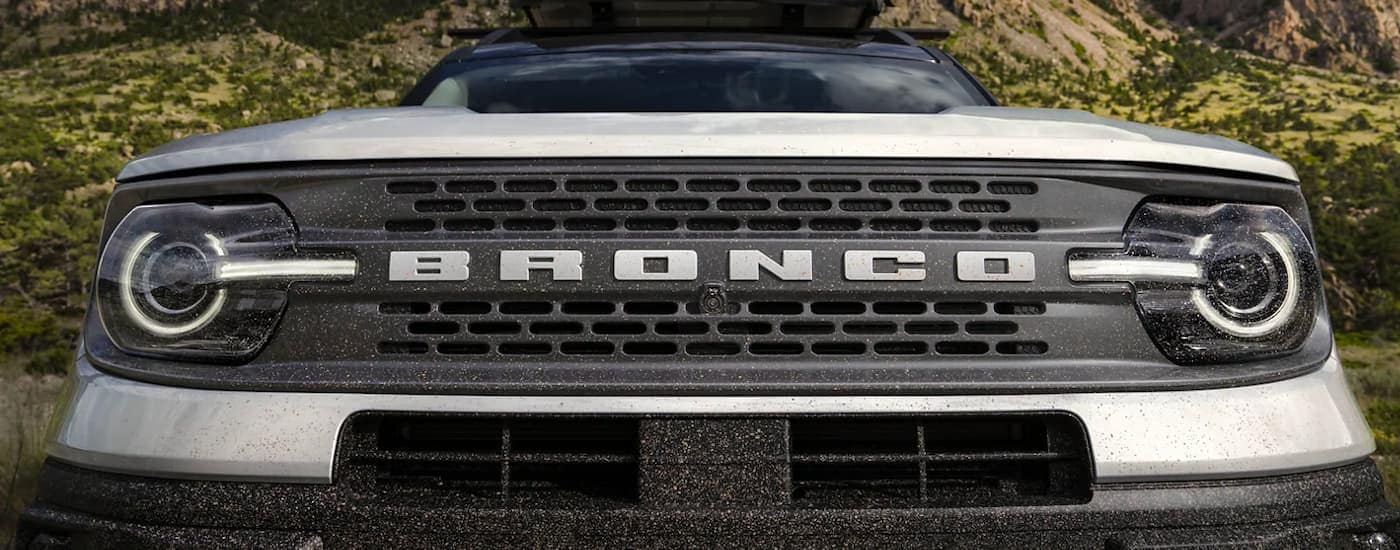 A close up shows the front grille from a low angle on a silver 2021 Ford Bronco Sport.