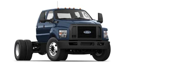 A blue 2021 Ford F-750 is angled right.