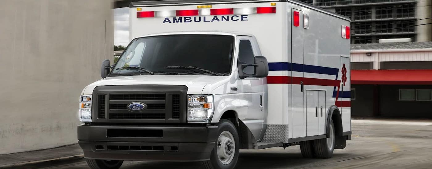 A white 2022 Ford E-Series Cutaway is shown with an ambulance body.