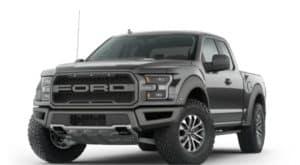 A black 2021 Ford F-150 Raptor is angled left.