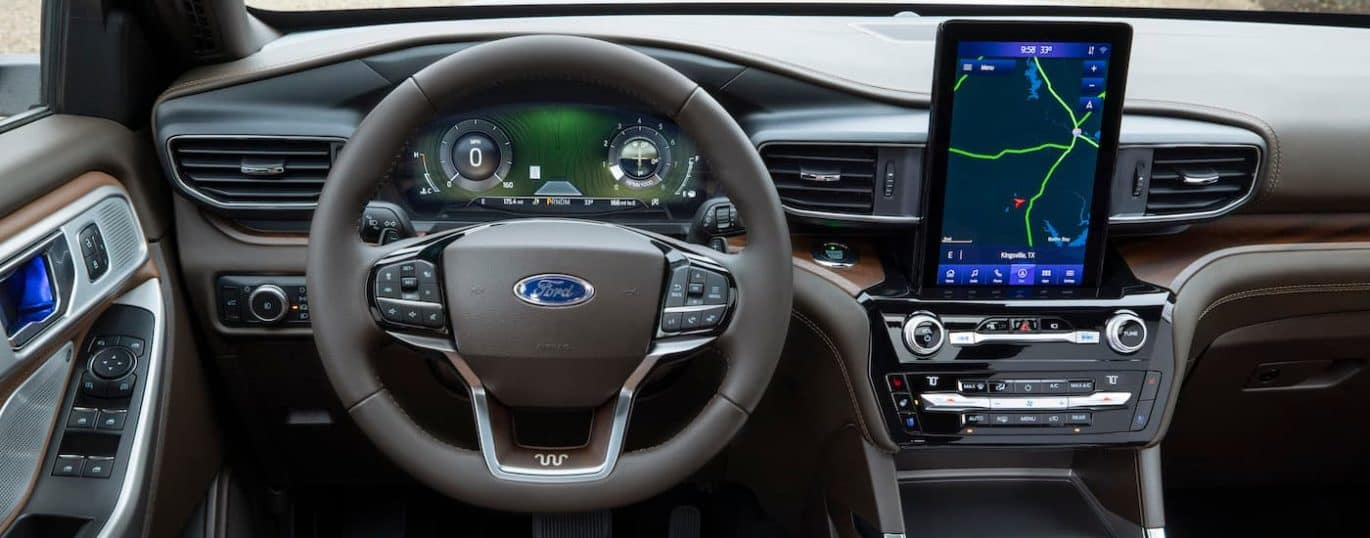 The black interior and infotainment screen are shown in a 2021 Ford Explorer.