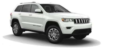 A white 2021 Jeep Grand Cherokee is angled right.