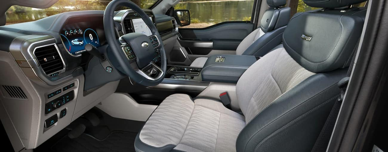 The black and white interior is shown in a 2021 Ford F-150.