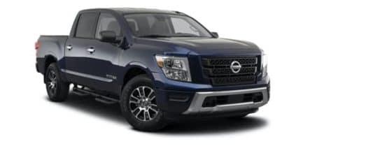 A dark blue 2021 Nissan Titan SV is angled right.
