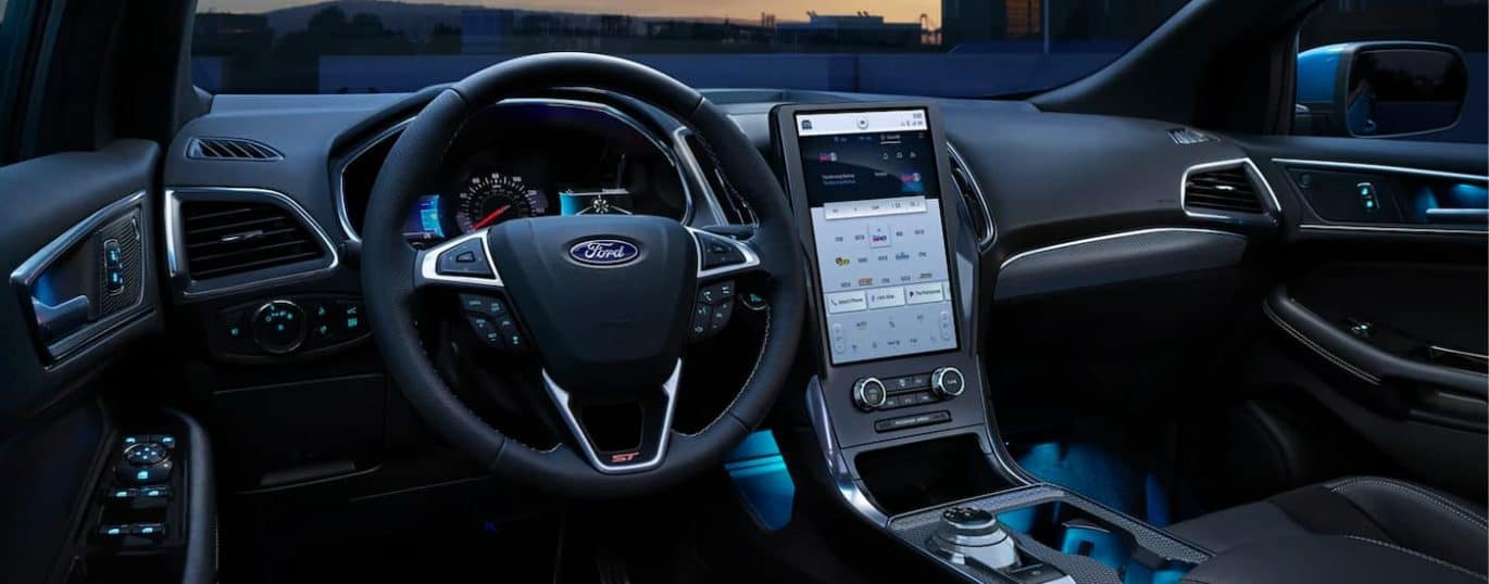 A close up shows the dash and infotainment screen in a 2021 Ford Edge ST.