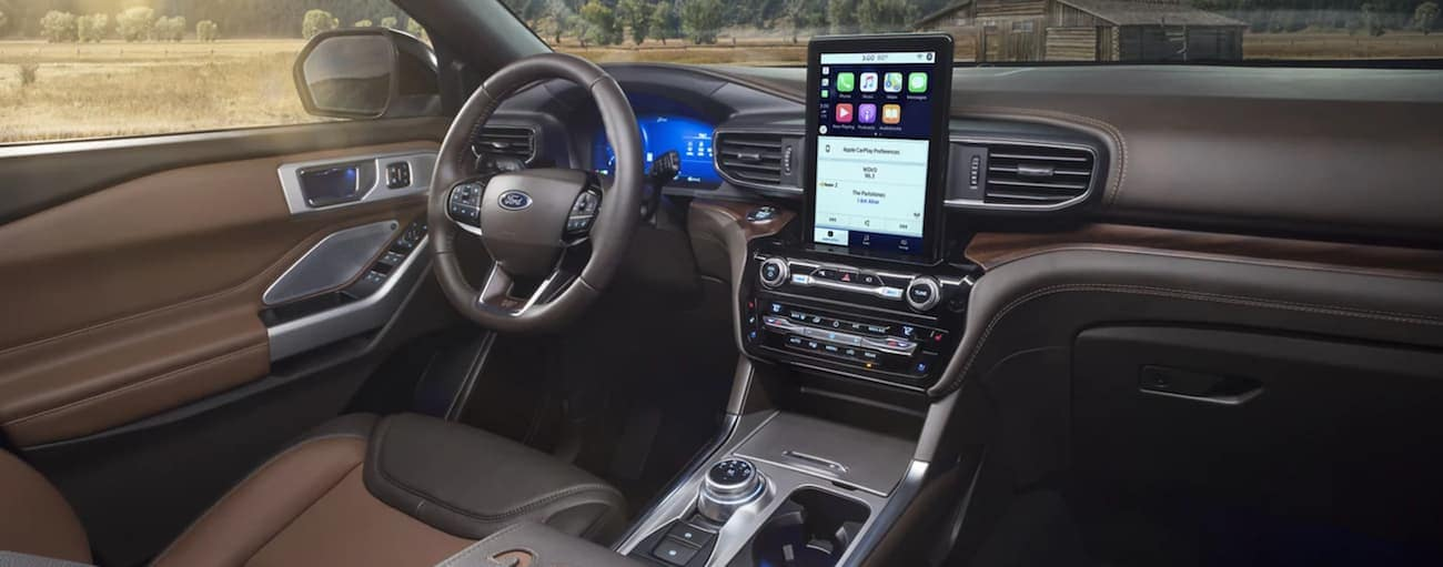 The brown interior of a 2021 Ford Explorer is shown.