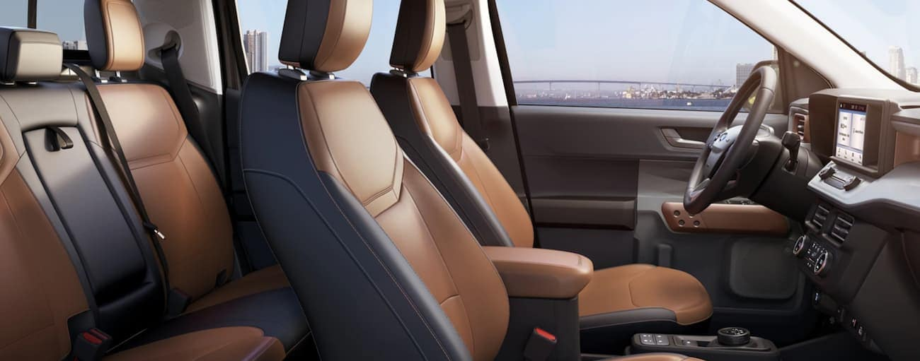 The interior of a 2022 Ford Maverick shows two rows of seating.