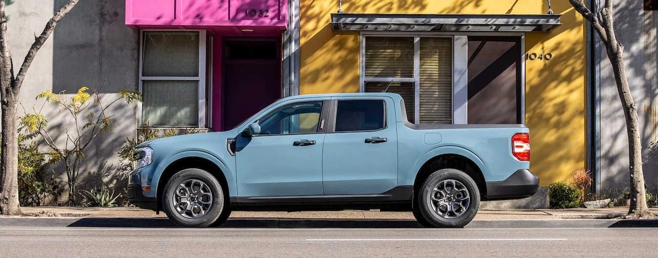 A light blue 2022 Ford Maverick is parked on a city street.