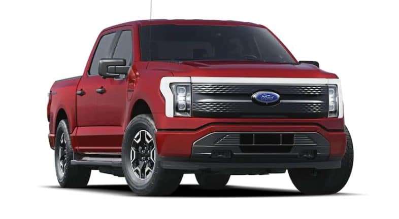 A red 2022 Ford F-150 Lightning is shown angled right.