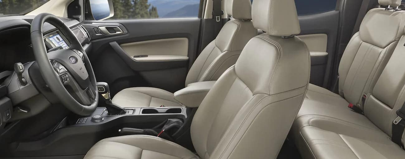 The interior of a 2021 Ford Ranger shows two rows of seating and the steering wheel.