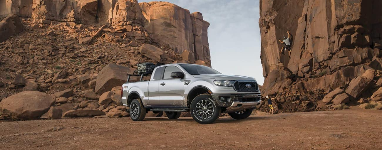 A silver 2021 Ford Ranger is shown from the side parked in a rocky desert.