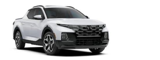 A white 2022 Hyundai Santa Cruz is angled right.