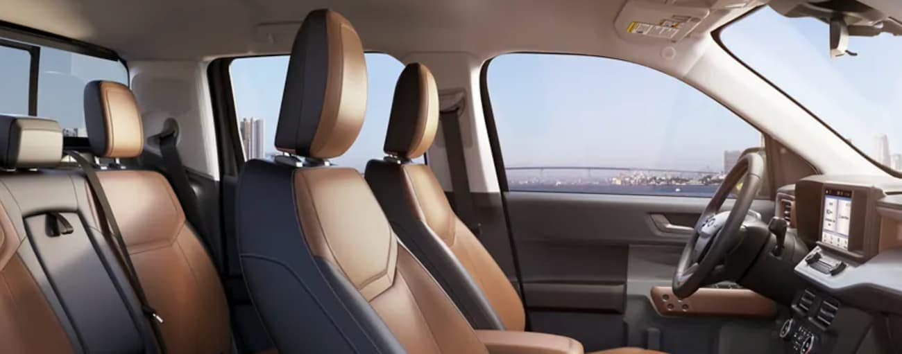 The interior of a 2022 Ford Maverick shows two rows of seating and a steering wheel.