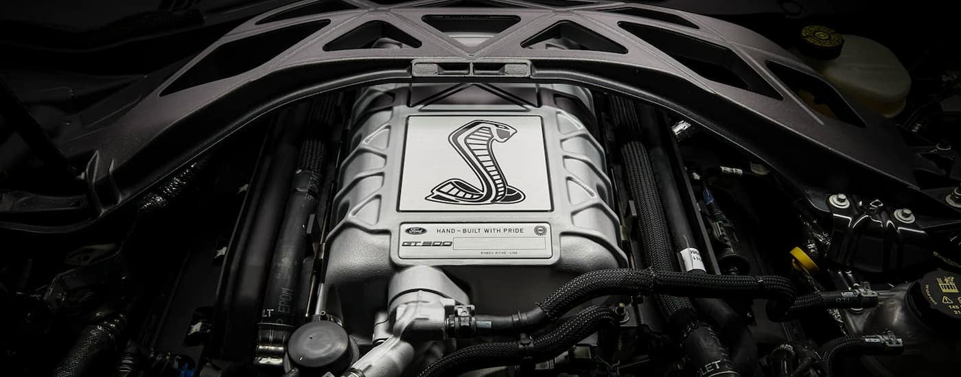 A close up shows the engine in a 2021 Ford Mustang Shelby GT500.