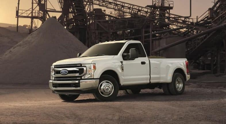 A white 2022 Ford Super Duty is shown angled left parked at a construction site.