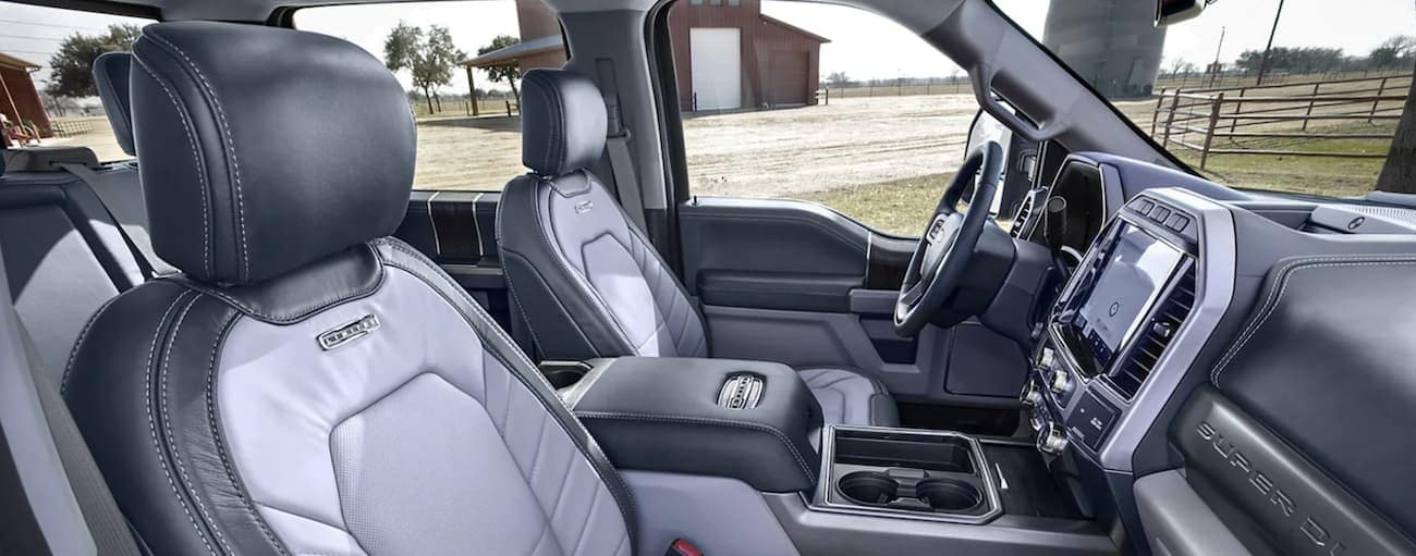 The interior of a 2022 Ford Super Duty shows the steering wheel and cab.