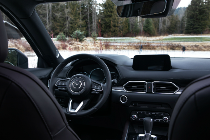 black leather crossover suv interior with chrome accents in a 2020 Mazda CX-5 sport utility vehicle