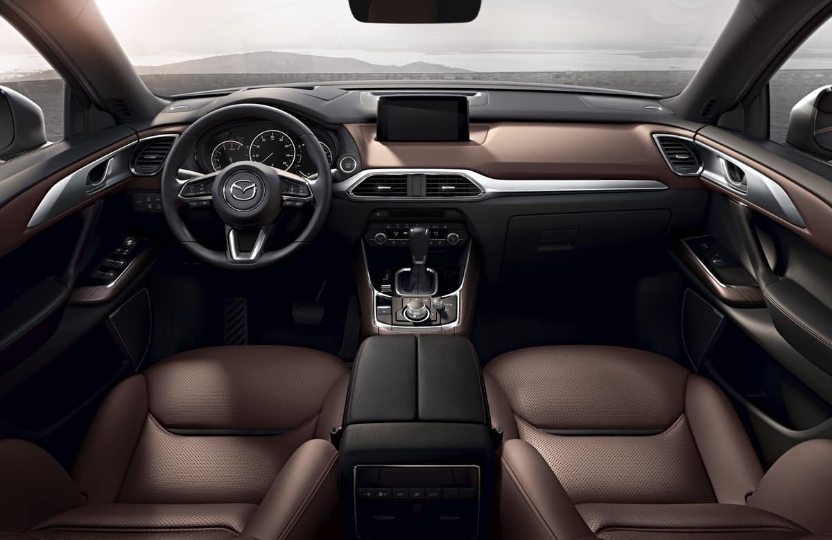 brown and black leather interior of a 2020 Mazda CX-9 mid-size third-row SUV with chrome accents