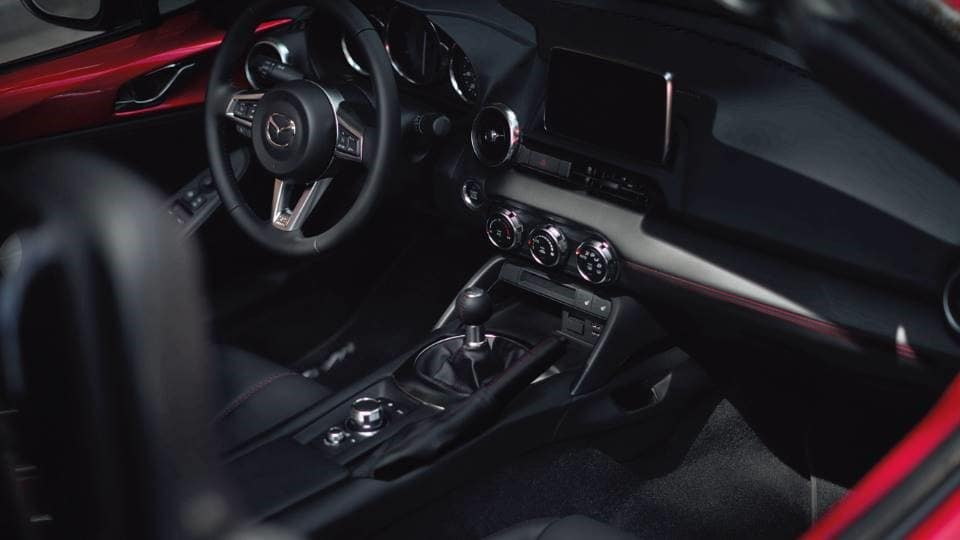 vehicle black leather interior with chrome accents in a 2020 Mazda MX-5