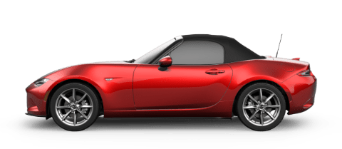 Side view of red crystal MX-5 Miata with black roof