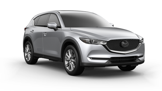 silver 2021 Mazda CX-5 with silver door mirror caps, chrome rims, and chrome accents around the grille