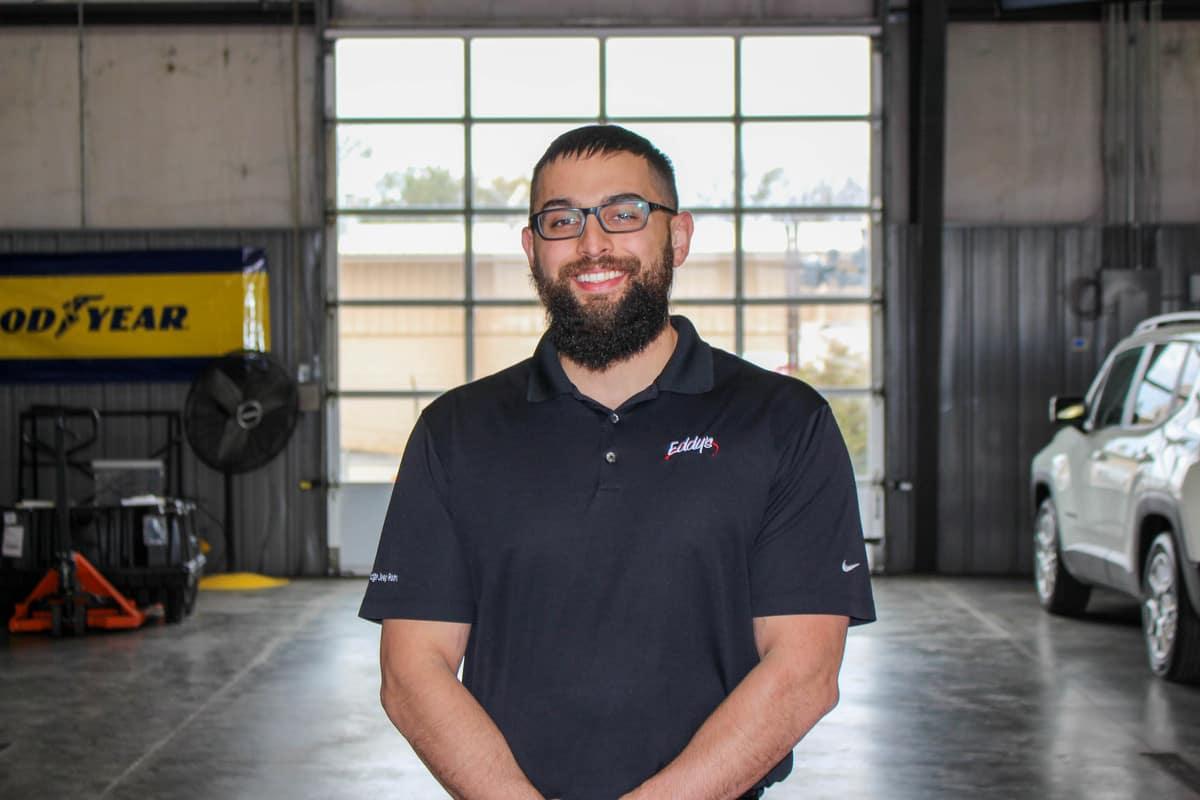 Man Standing In Garage Smiling