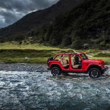 2018 Jeep Wrangler 4 Door driving through the water