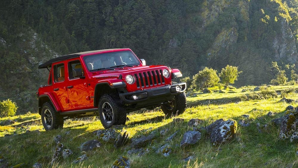 2019 Jeep Wrangler in a mountain meadow