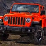 2019 Jeep Wrangler in orange on mountain