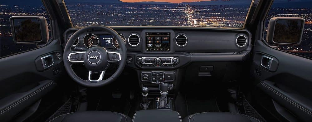 2019 Jeep Wrangler Sahara interior dashboard and steering wheel