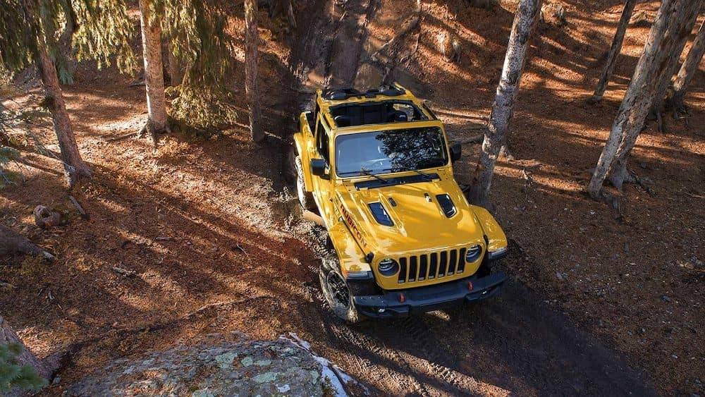 2019 Jeep Wrangler off-roading on a muddy trail