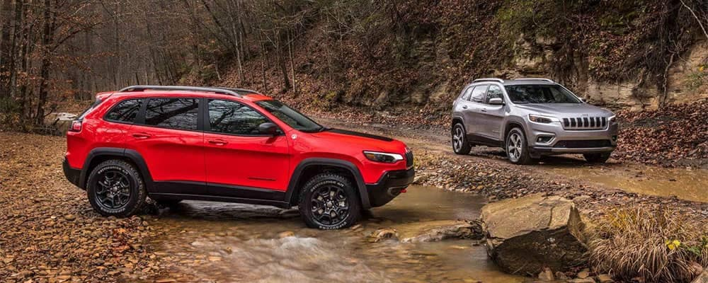 Jeep Cherokee Models Parked On Off-Roading Trails